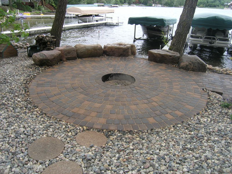 Outdoor Paver Firepit With 3 Metal Fire Ring Fieldstone Seating Wall And  Step Stones In River Rock Patio Fireplace