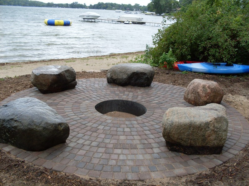 Paver Firepit With Big Boulder Outcroppings Used For Sitting Around Camp Fire  Paver Patio ...
