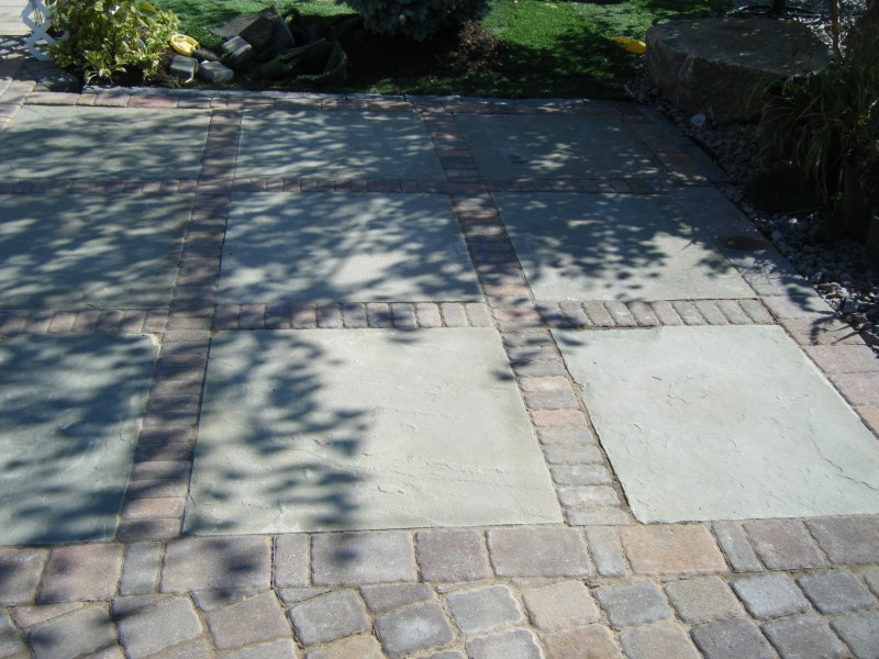 Bluestone Patio Accented With Landscape Pavers To Match Paver Driveway ...