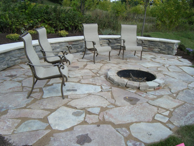 Outdoor Patio Fire Pit - Raised Limestone Fire Pit, Irregular Fond du Lac  Limestone Patio and Seatwall surrounded by Naturalistic Plant Materials ... - Natural Stone