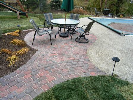 Captivating Round Paver Patio And Brick Paver Walkway Tied To Existing Concrete Pool  Deck ...